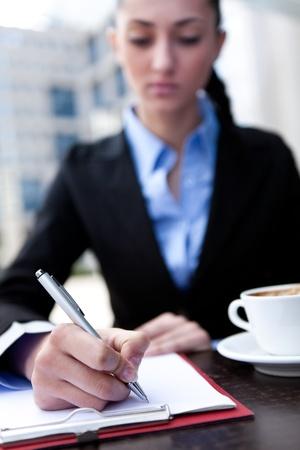 businesswoman make notice on coffee break  photo