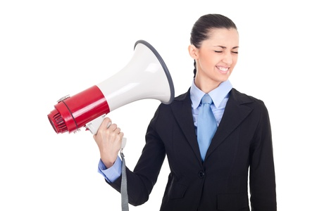 boss shouting through loud speaker on businesswoman, face expression, isolated on white photo