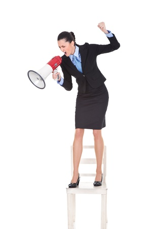 angry boss with megaphone yelling and standing on chair, shoving protest, isolated on white background  photo