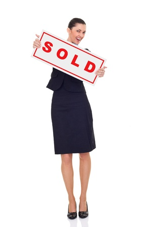 real estate agent or businesswoman holding sold sign , isolated on white background, full length photo