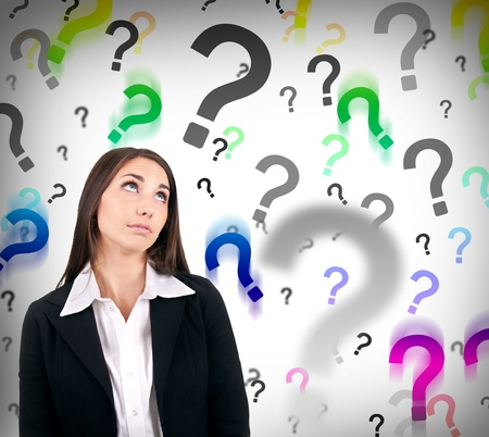businesswoman with question marks behind her, hard decision Stock Photo - 9653510