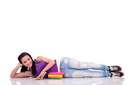 lying on floor:  student girl relaxing on floor , smiling and looking at camera, isolated on white Stock Photo
