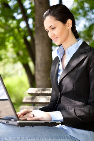 businesswoman with laptop working outdoor Stock Photo - 9769315