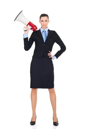 sexy businesswoman with megaphone  posing on white background photo