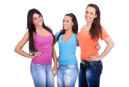 three color: three young girls teenagers, posing on white background
