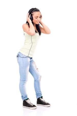teenage girl enjoying in music,  isolated on white background photo