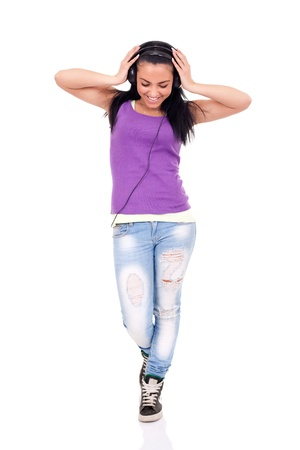 happy teen girl listening to music, full length, isolated on white Stock Photo - 9769370