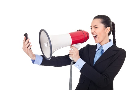 speaker phone: businesswoman yelling on phone through megaphone over white background