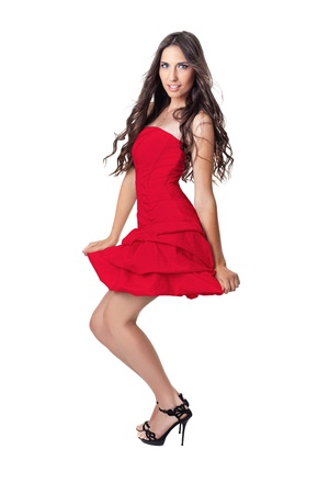 woman is short red,  dress, posing on white background photo