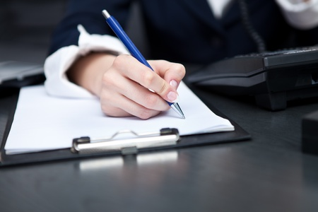 hand of the businesswoman writing note (hand with pen in focus) Stock Photo - 10275067