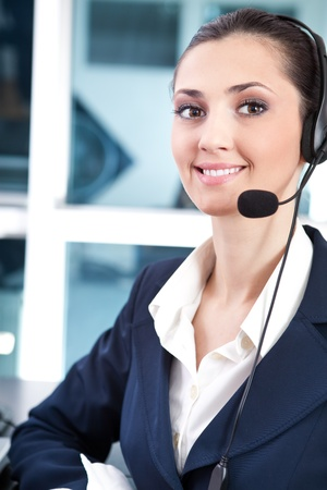support phone operator with headset at workplace  photo