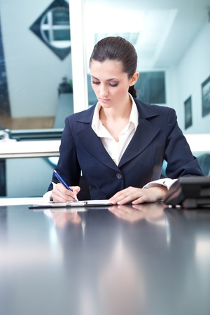 beautiful young businesswoman working in her office Stock Photo - 10275210