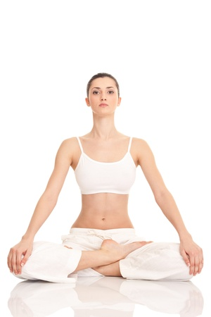 positive feelings: young woman doing yoga exercise, isolated on background