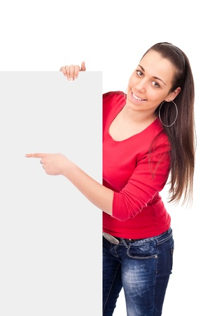 student girl pointing on blank paper,  isolated on white background photo