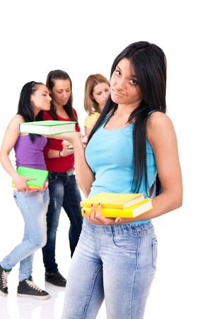 highschool: unhappy  student girl with the classmates on the background, isolated Stock Photo