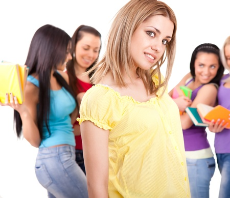 woman and a group of university students smiling, isolated on white background photo