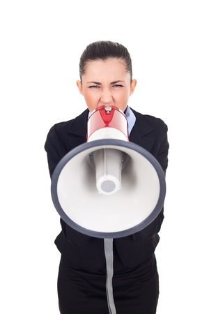 businesswoman as public speaker, shouting through megaphone, isolated on white photo