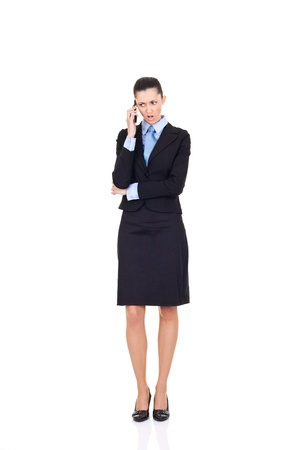 businesswoman receives bad news over the phone, isolated on white background photo