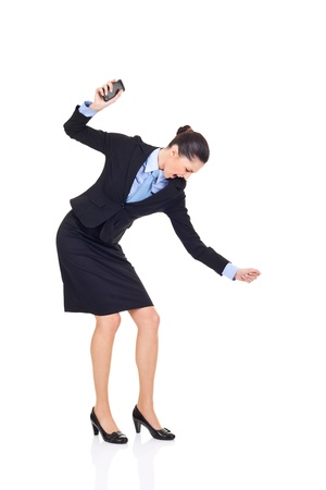 Angry businesswoman smashing her phone, isolated on white background photo