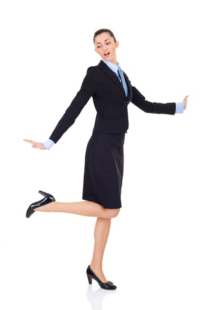 businesswoman celebrating success with dancing, isolated on white background photo