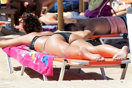 sexy girl enjoying in sunbathing photo