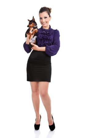fashion,  sexy woman with her miniature pincher puppy,  isolated on white background photo