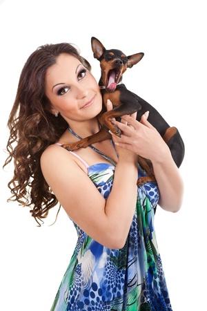 beautiful  girl holding little, sweet  yawning dog, isolated on white background photo