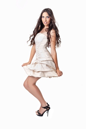 sexy young woman in little white dress, isolated on white background photo