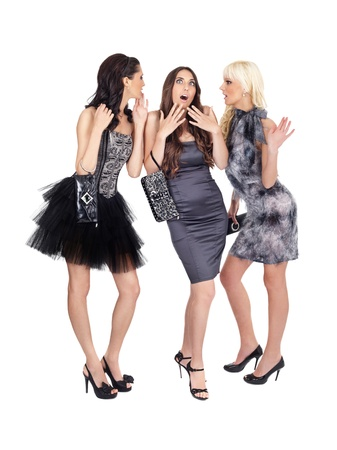 group of girls in fashion dresses with expressing face, isolated on background photo