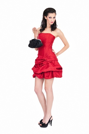 passion woman in red  fashion dress posing with purse, isolated on white background Stock Photo - 10274930