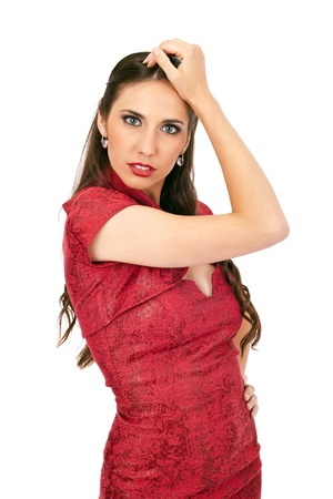young sexy brunette in red dress on white background, portrait Stock Photo - 10274888