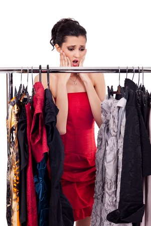 fashion woman with problems, make a decision what to wear, isolated on white photo