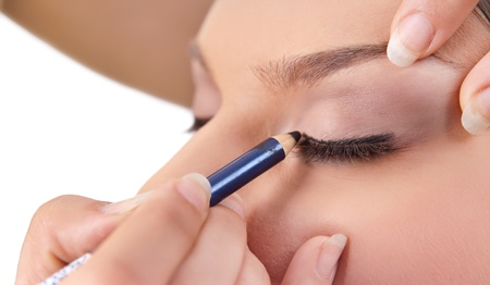 beautification: make-up artist applying beautiful make up eyeshadow, close up,