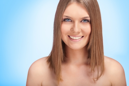 portrait of a young, beautiful caucasian woman, with blue background Stock Photo - 10275244