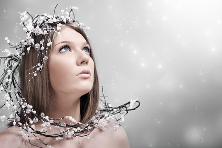 fantasy makeup: beauty woman with decoration of pearls in hair, looking up Stock Photo