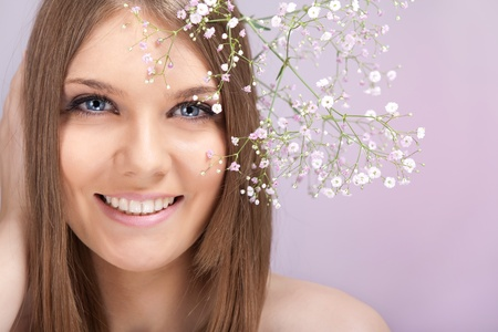 beauty woman  with small white flowers in hair photo
