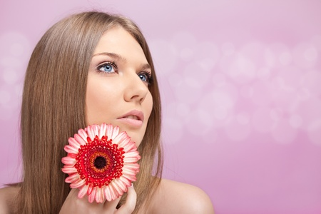 Portrait of beautiful blond woman with flower Stock Photo - 10275169