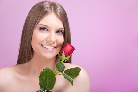 beautiful smiling girl with red rose photo