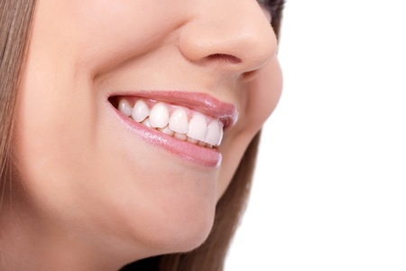 dentition:  woman smiling with great teeth on white background