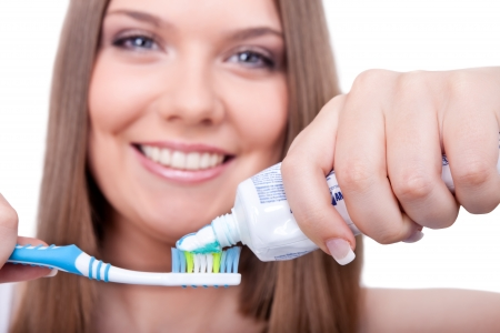 young woman with toothbrush and paste, dental hygiene, isolated on white background photo