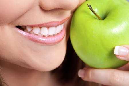 dentist concept: healthy teeth and green apple, close up Stock Photo