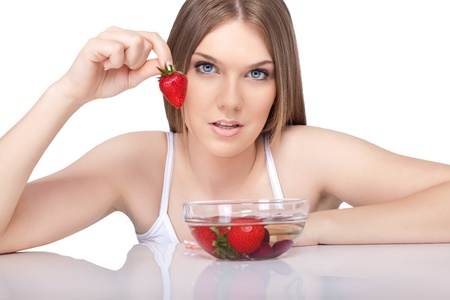 portrait of woman eating strawberry,  healthy smiling woman eating strawberry , isolated on white background photo