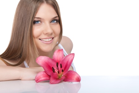 fresh beautiful woman with  pink lily, isolated on white background photo