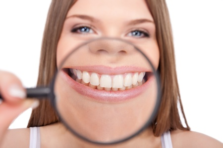 perfect teeth: young woman showing her healthy teeth, isolated over white background
