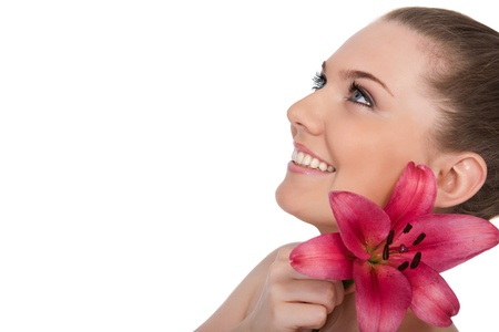 beautiful sensual woman with pink lily smile isolated on white photo