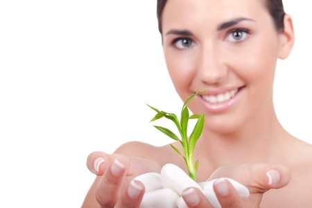 eco sensitive: Beauty healthy woman holding young green plant in hands, isolated