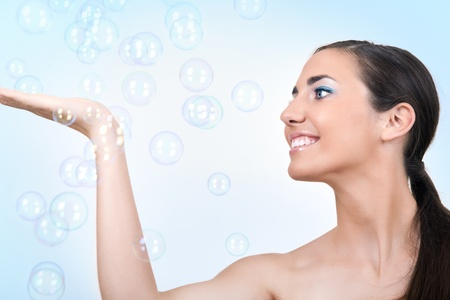 beautiful young woman  having a bath smiling and enjoying in bubbles photo