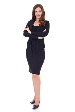 skirt suit:  attractive,   young businesswoman standing, isolated on white background