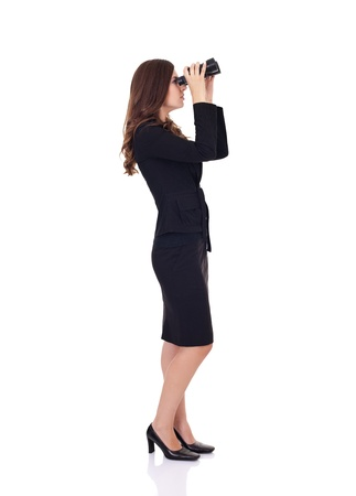 Young businesswoman looking through binoculars in competition  photo