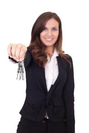 female real estate agent giving a home buyer the keys, isolated on white background Stock Photo